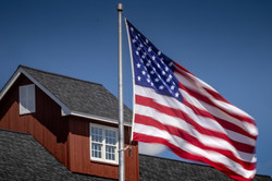 American Flag in front of house.