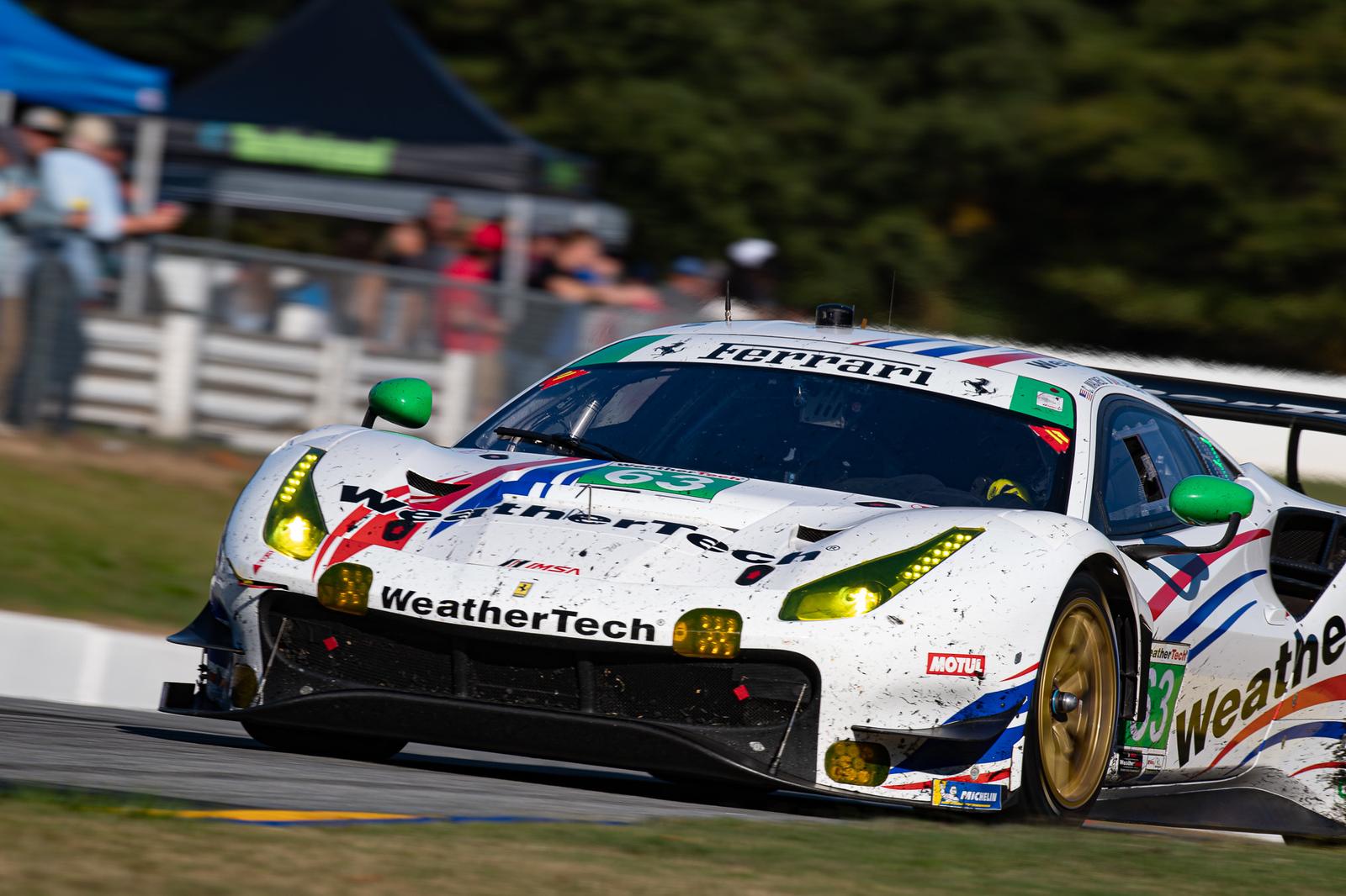 Ferrari rounding a curve.