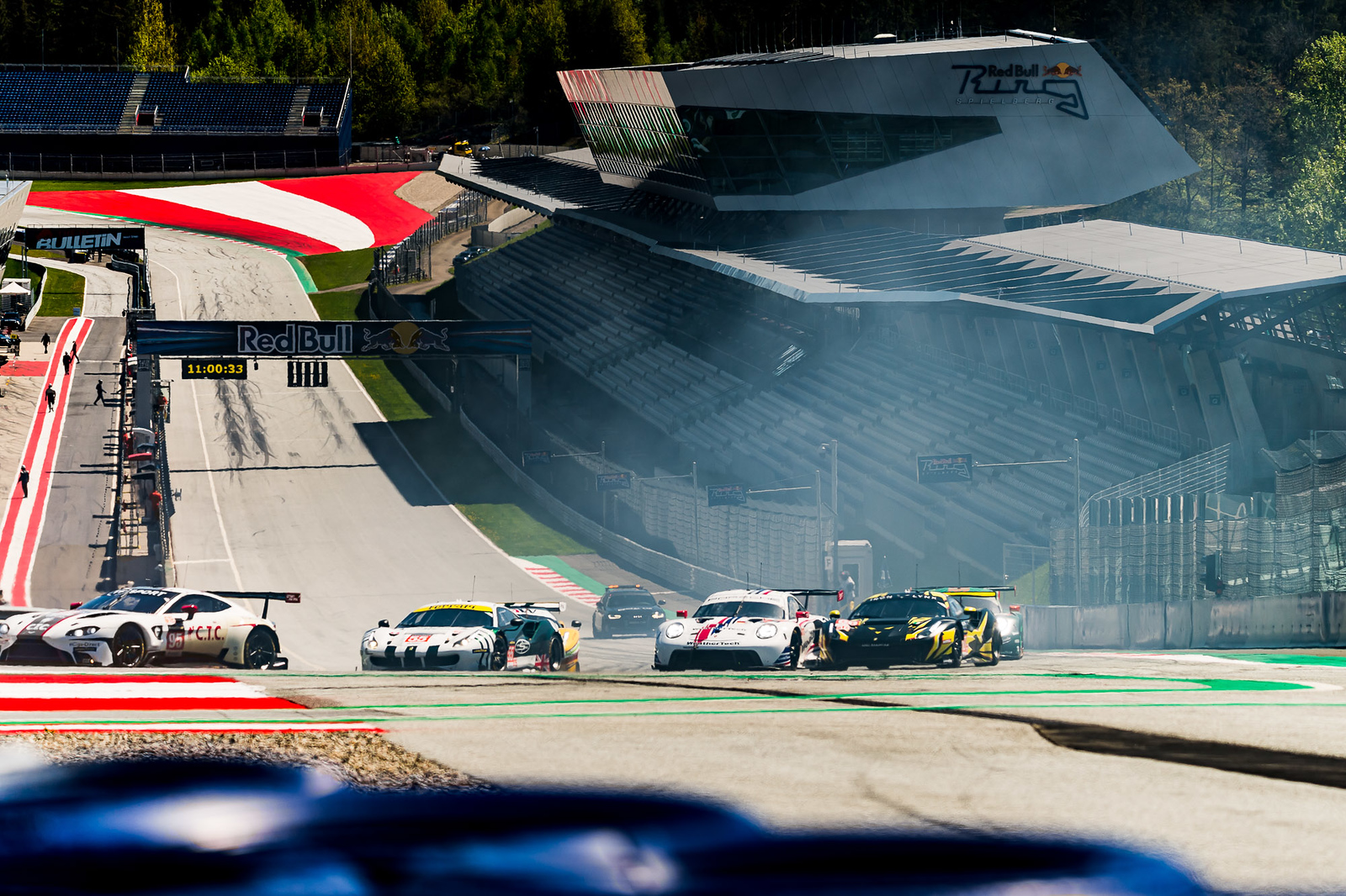 Porsche in the midst of the track.
