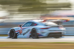 Porshce racing around track.