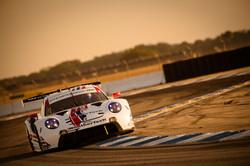 Porsche riding around a turn.