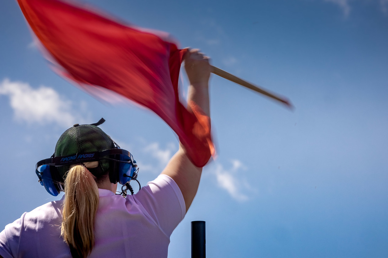 Girl waving red flag.