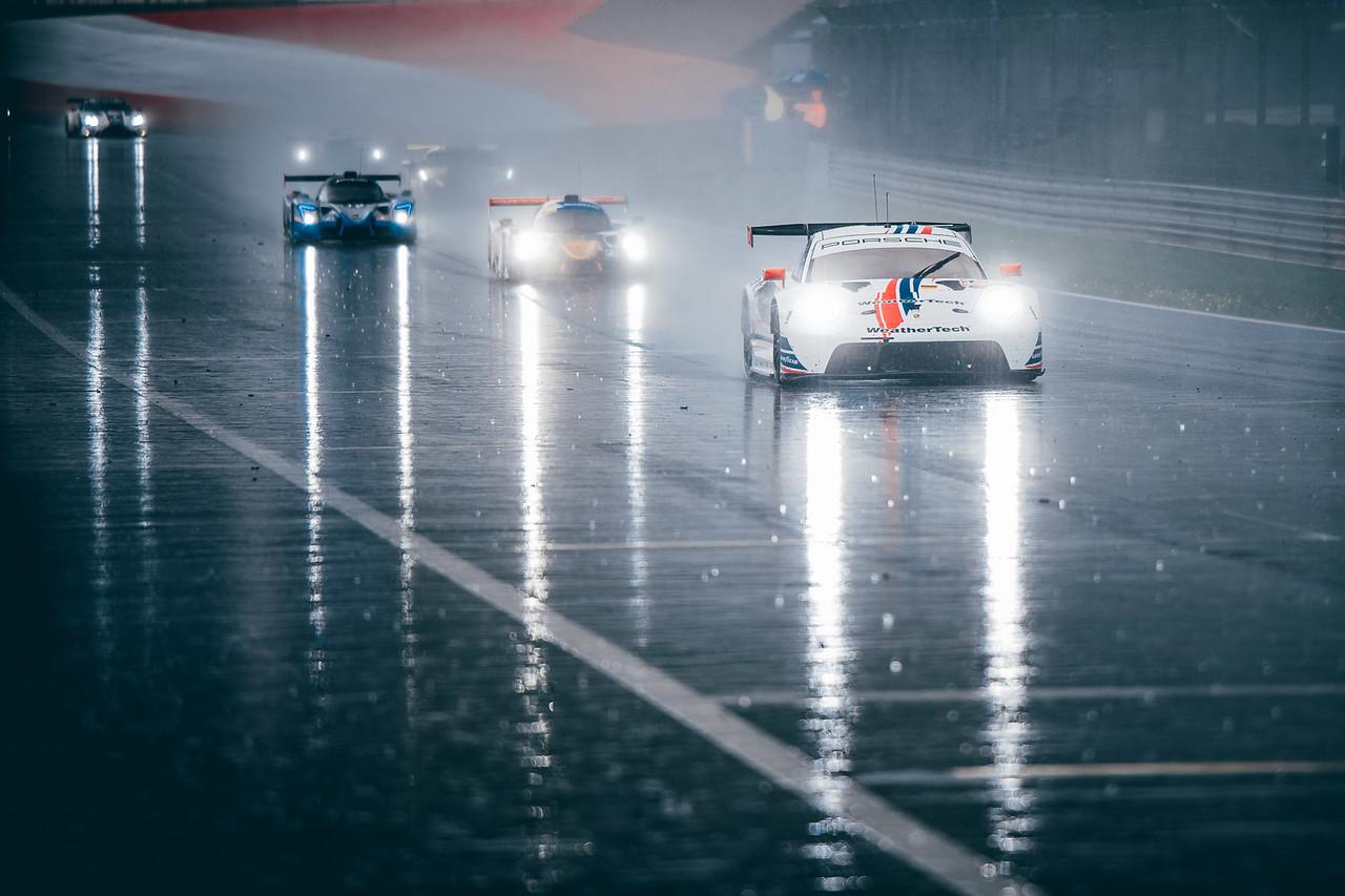 Porsche driving in the rain.