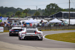Porsche racing into a turn.