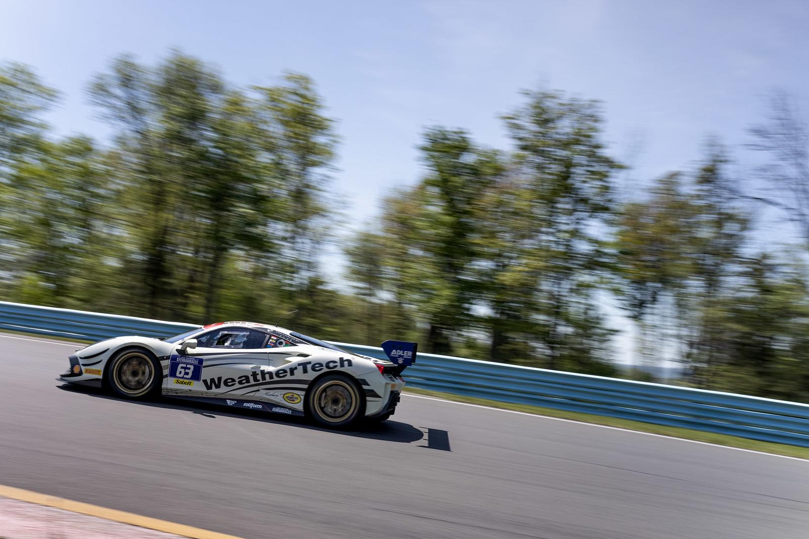 Ferrari hugging a turn.