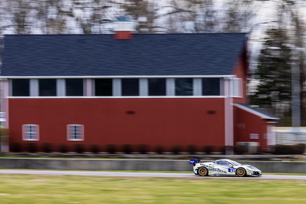 Ferrari picking up speed on the track.