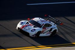 Porsche rounding a turn_