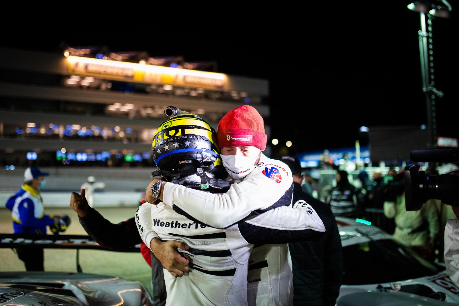 Drivers hugging.