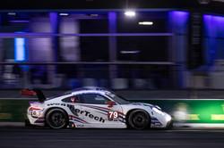 Porsche on the straightaway at night.