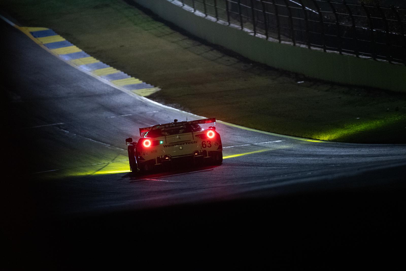 Ferrari on the track at night.
