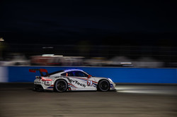 Porsche racing at night.