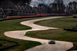 Ferrari racing up the track.