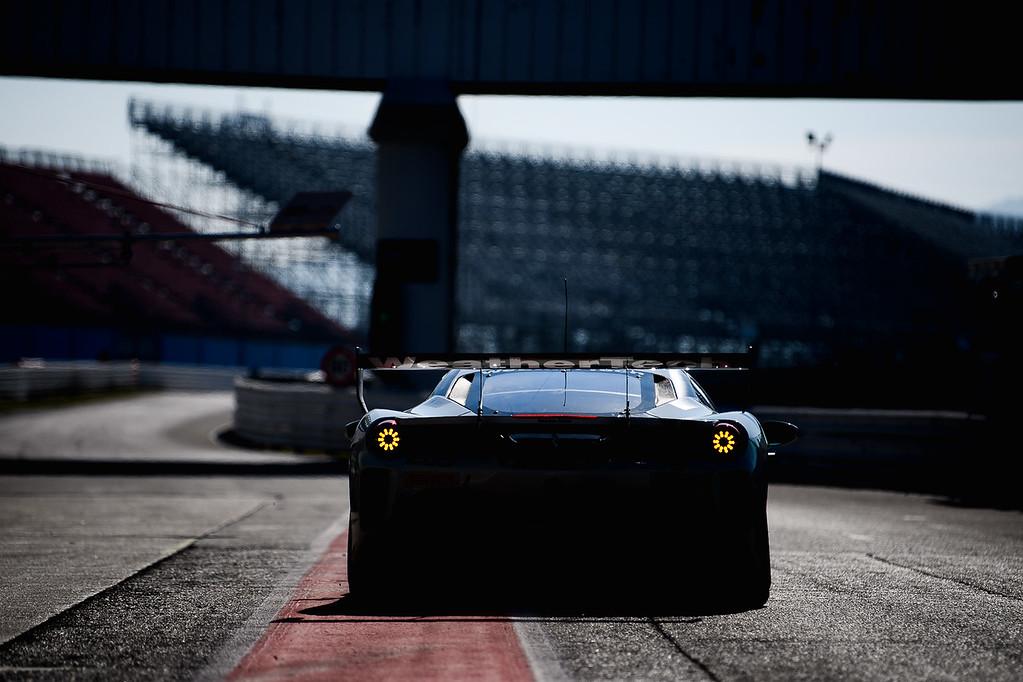 Rear view of the Ferrari near dusk.