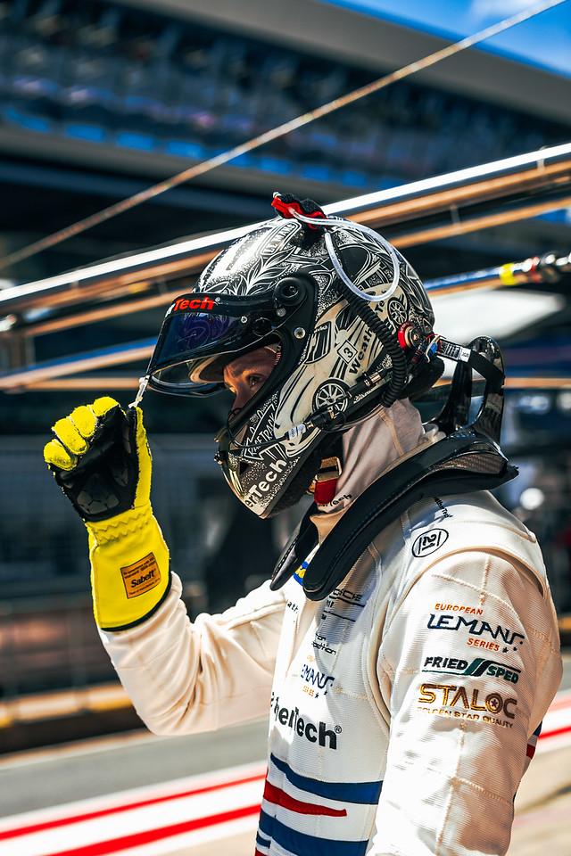 Cooper in his racing helmet.