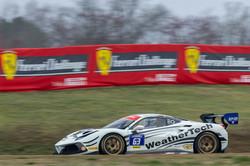 Ferrari racing full throttle.