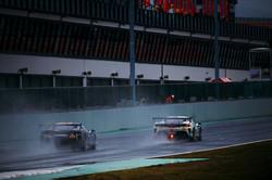 Ferrari racing in the rain.