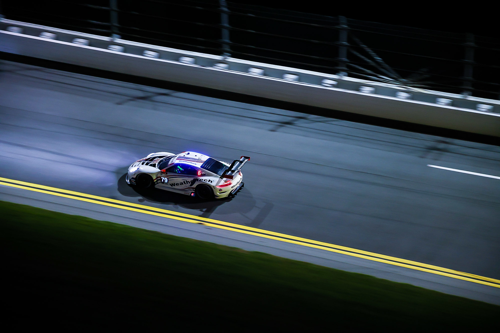 Porsche on the track at night_