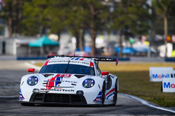 Porsche racing on track.