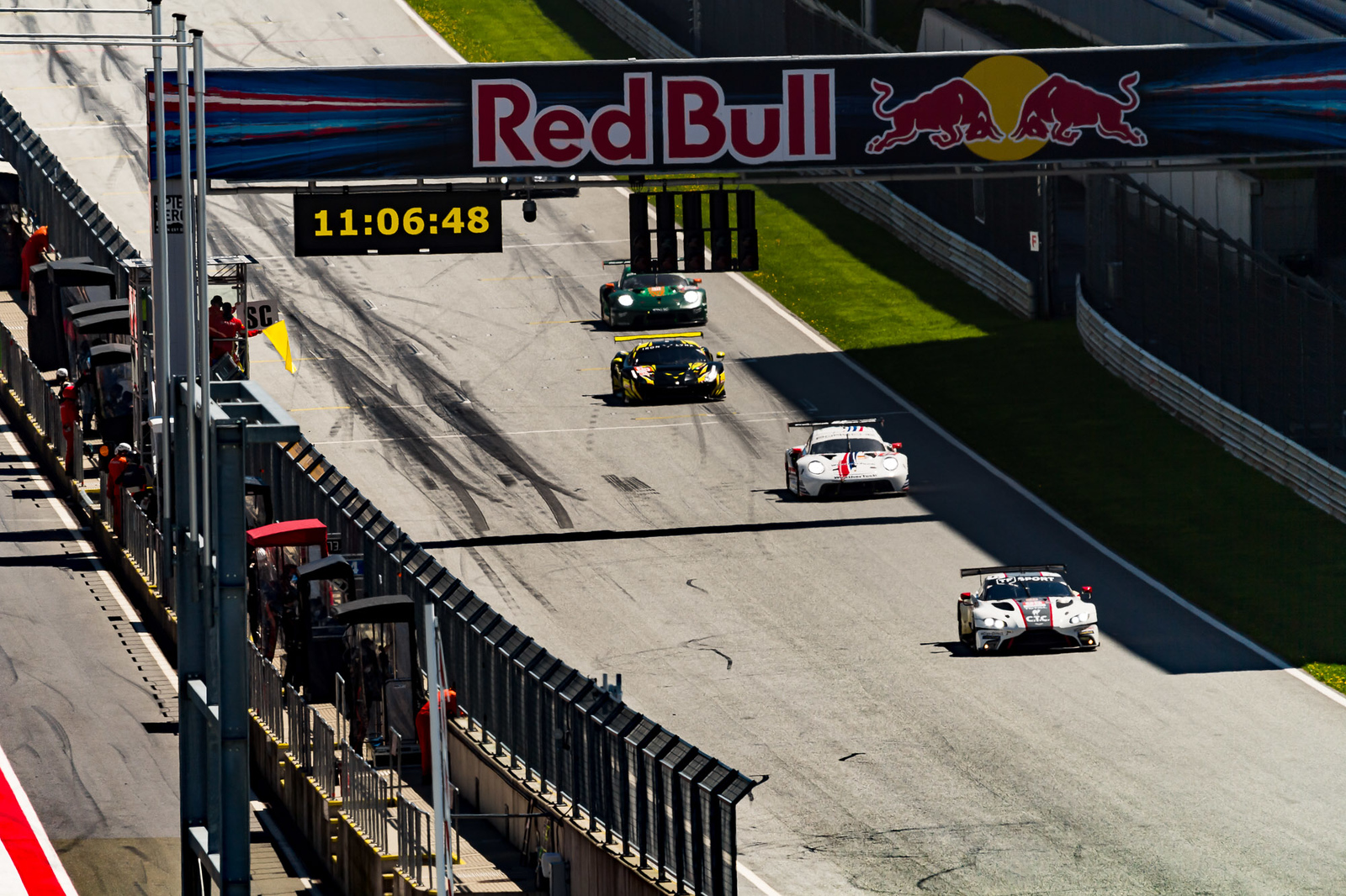 Porsche racing past the starting line.