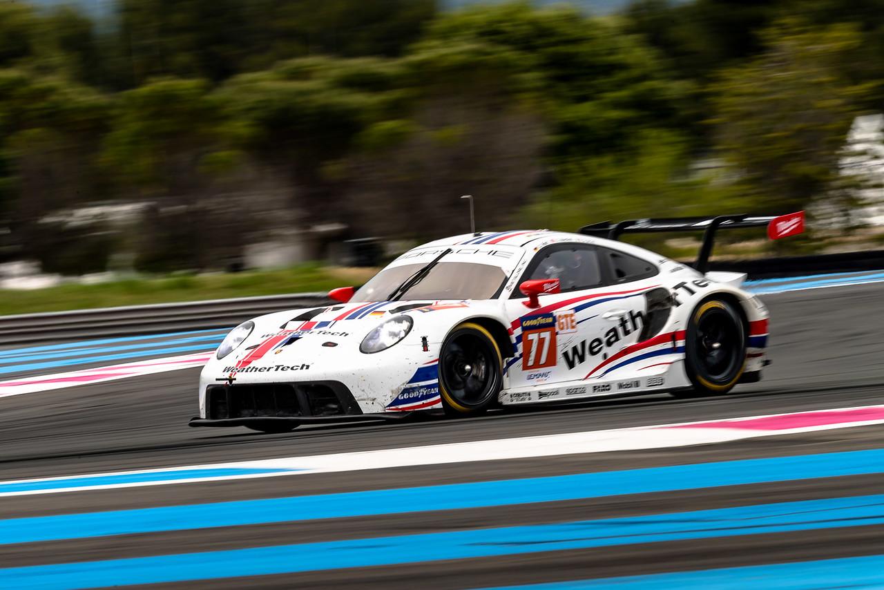 Porsche coming down a hill.