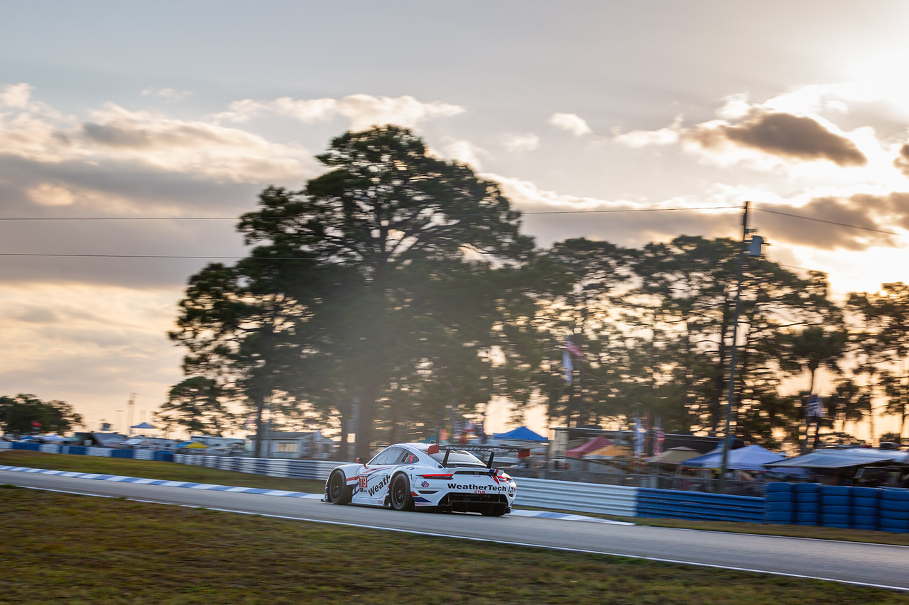 Porsche racing at sunrise.