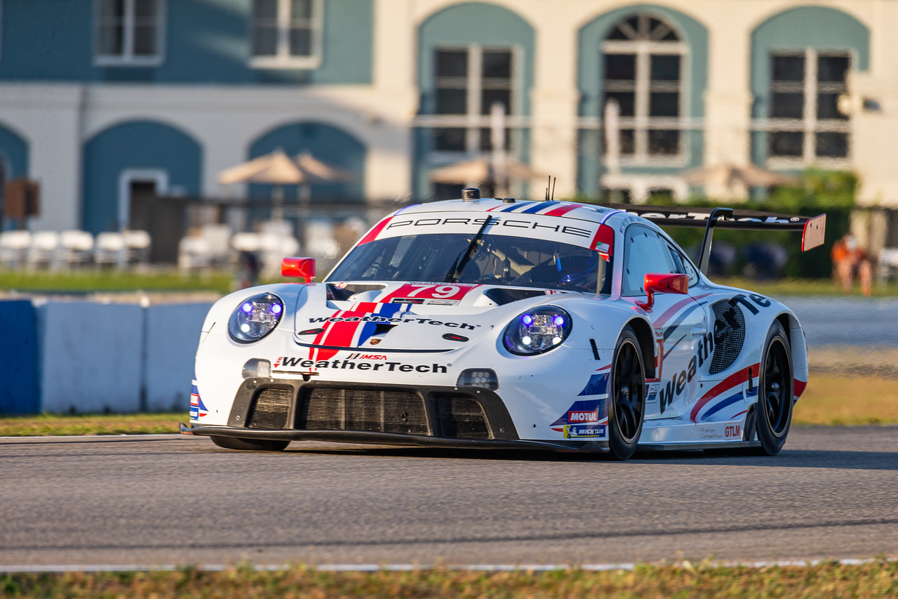 Porsche rounding a left turn.