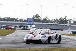 Porsche rounding a turn.