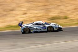 Ferrari racing on a straight away.