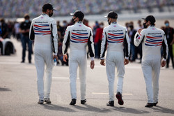 Drivers walking on track_
