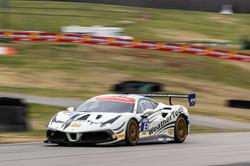 Ferrari full throttle over a curve.