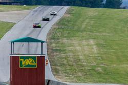 Cars racing uphill.