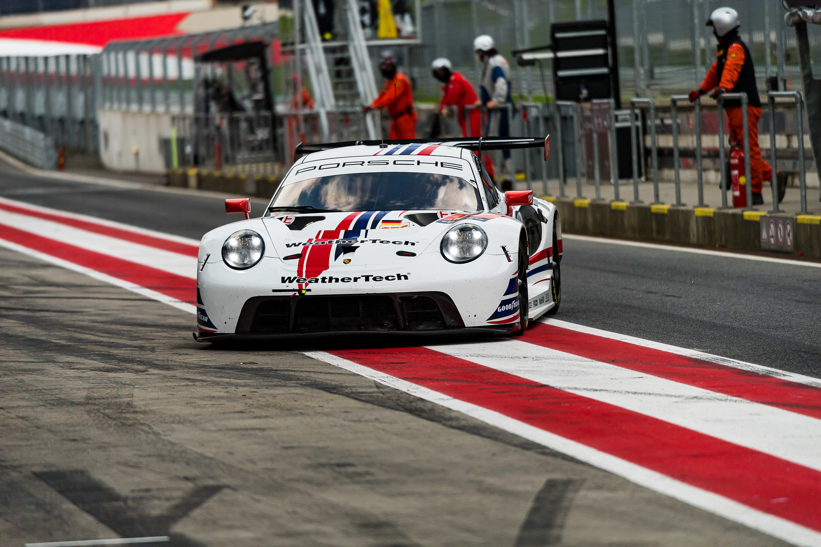 Porsche pulling into the pit.