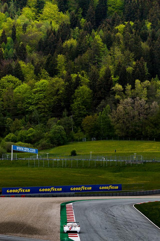 Porsche driving around the track.