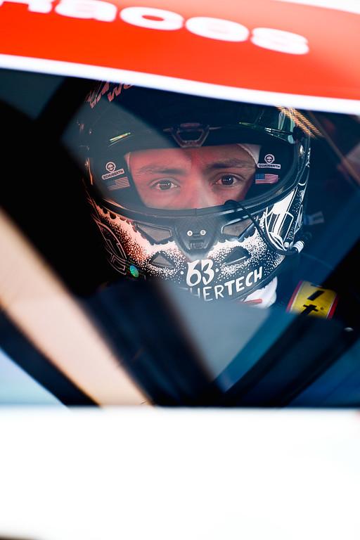 Cooper MacNeil in drivers seat.