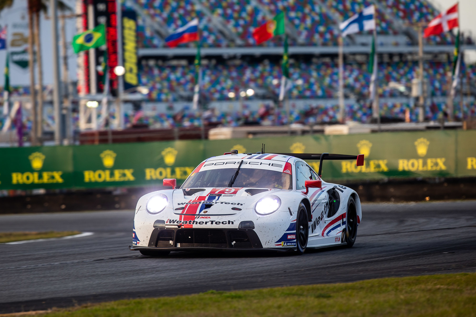 Porsche driving on track_