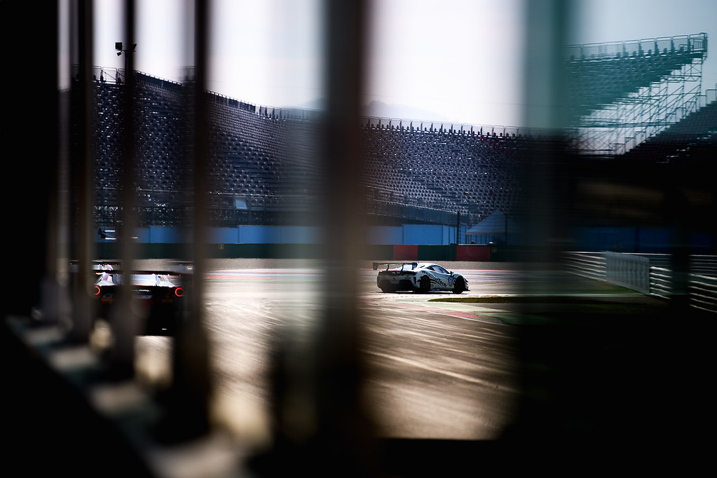 Ferrari racing around a turn.