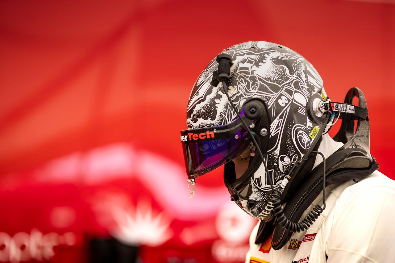 Cooper in helmet on pit road.