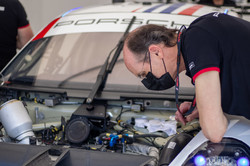 Crew member checking the engine.