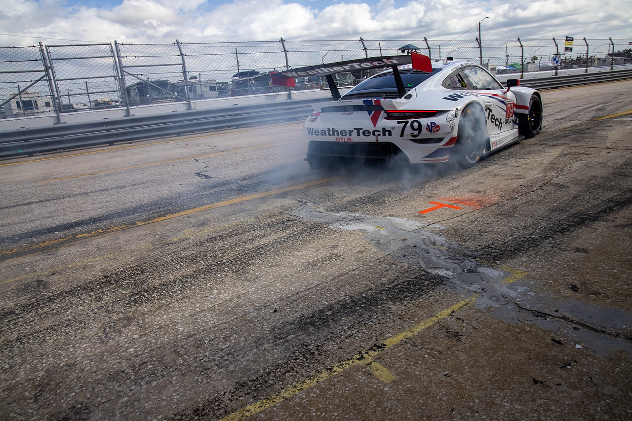 Porsche peeling out of pit road.