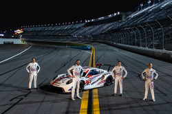 Drivers standing on track with car_