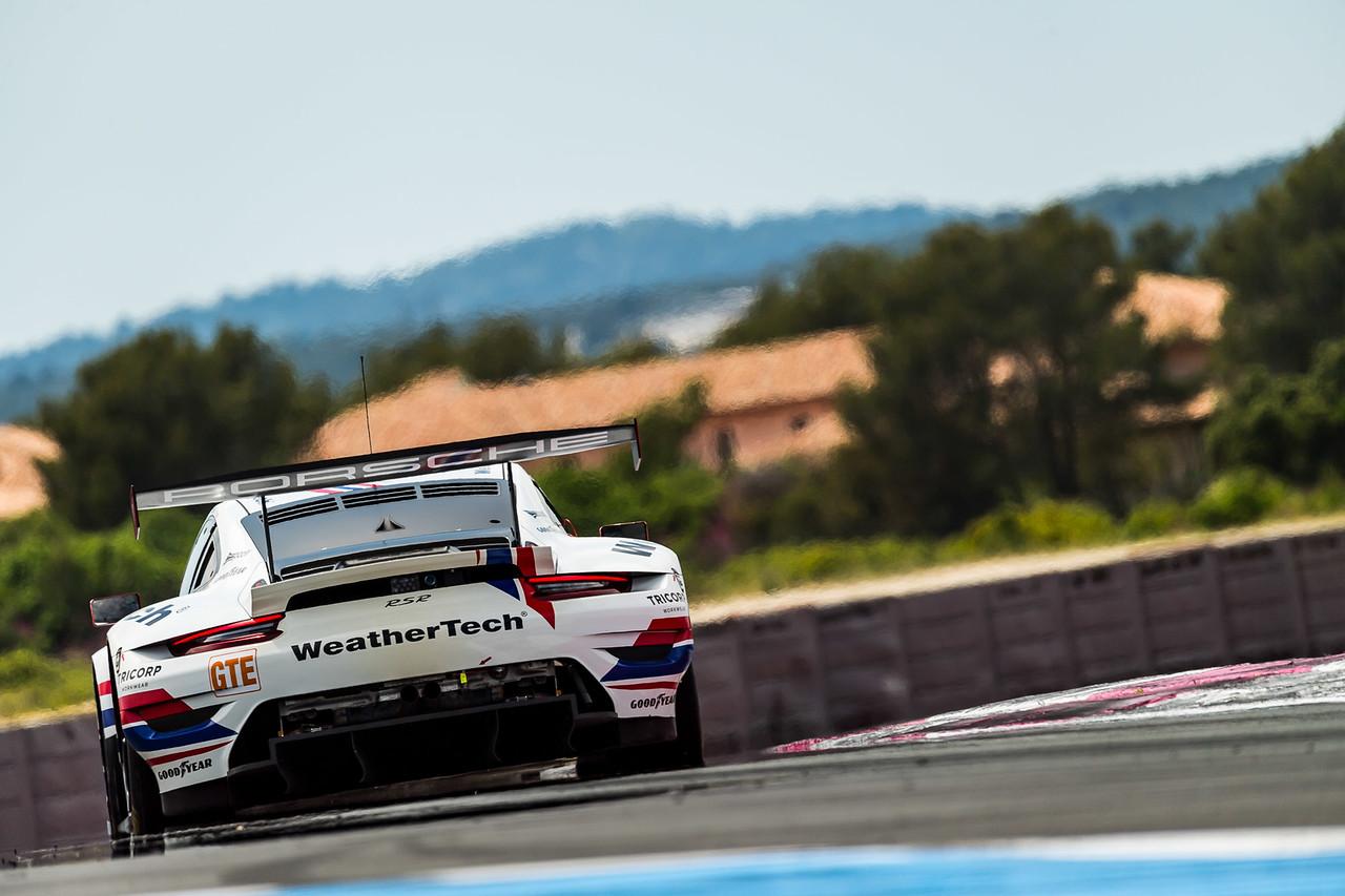 Porsche rounding a curve.