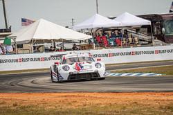 Porsche racing on a turn.