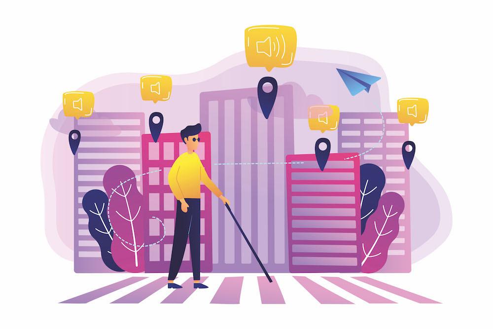 Ilustración de una persona con discapacidad visual transitando paso peatonal en una ciudad accesible e inteligente, La imagen la ciudad es de edificios con colores rosa, violeta y tonos morados, el hombre que transita lleva una camisa amarilla y pantalón negro usa lente y bastón