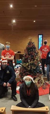 Gathering around the Christmas tree.