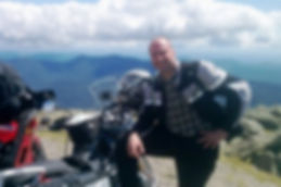 Customer Ed stading ontop of amountain with BMW R 1200RT
