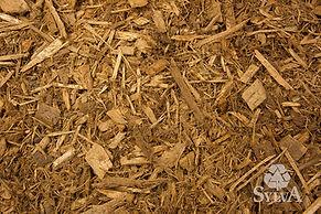 Amber toned golden brown shredded fiber mulch