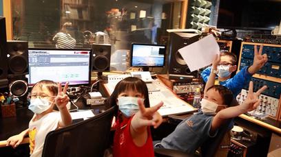 Kids singing in studio.png