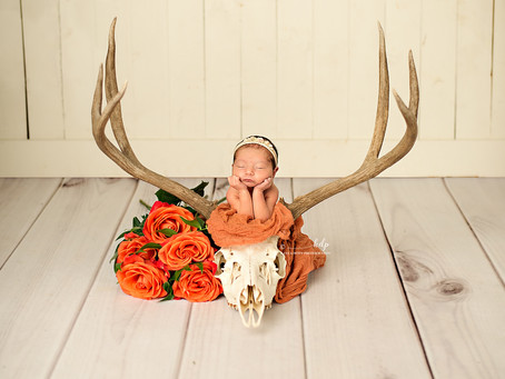 Remi | Hunting and Floral Newborn Photography