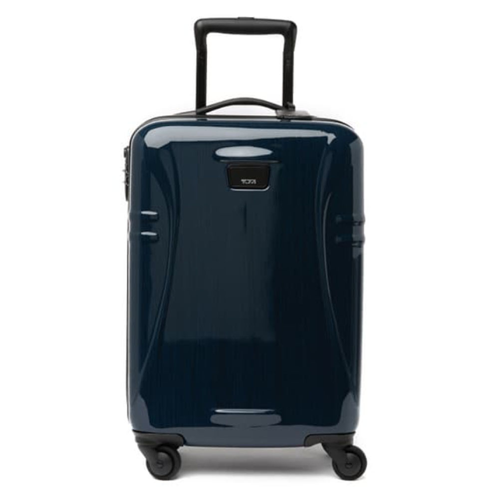 international 21 inch carry-on suitcase in navy from tumi