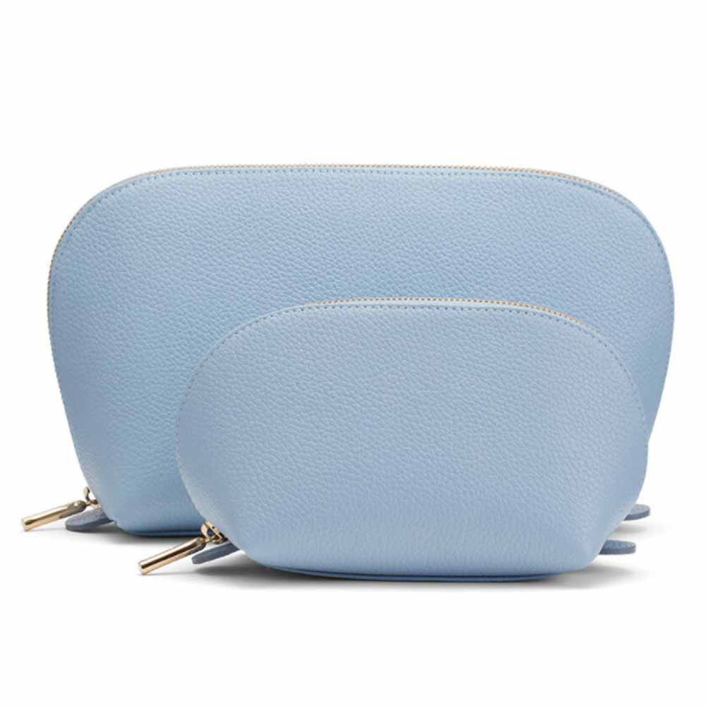 leather travel case set in dusk blue color from cuyana